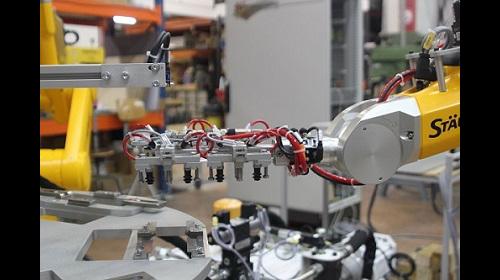 poste robotisé, préhenseur spécifique